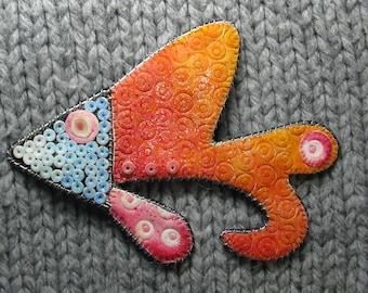 Orange fish pin