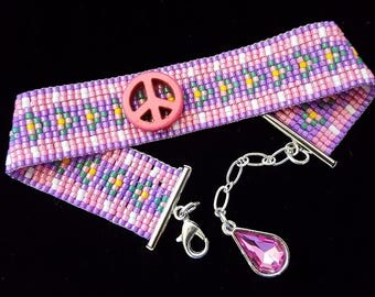 Pink and purple peace bead-woven bracelet