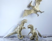 Gold dinosaur Christmas ornaments. Fun, alternative decorations, set of 3