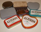 Lot of eight (8) tins, mostly Altoid tins. Some are new, but a couple have been primed.