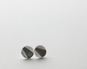 Geometric Silver Studs - black and silver raised angles