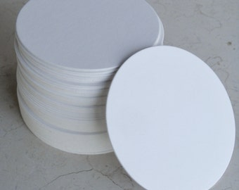 "Twelve blank coasters 3.375 inches diameter, .055"" thick and smooth white"