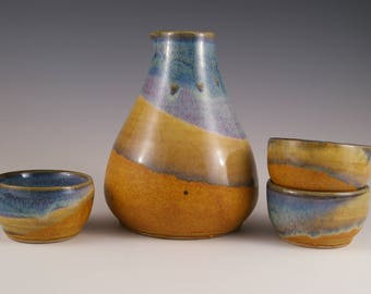 Sake set with 3 cups in brown and blue
