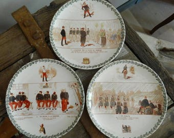 French Antique Choisy Le Roi Wall Plates with Humorous military scenes. Set of 3  Plates Stamped Choisy le Roi.