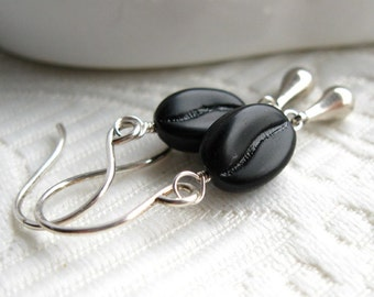 """Drip Coffee, Black.  Sterling silver earrings with black glass coffee beans and a """"drip"""" (Chamberlain)"""