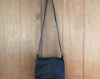 Vintage black leather stewardess hand bag with brass turn lock closure by Coach