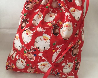 Christmas Fabric Gift Bag  Eco Friendly Bag  Drawstring Reuseable wrap --size 12 inches x 12 inches  Santa and Reindeer Fabric