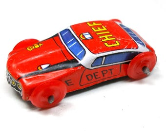 1960s tin toy fire chief car. Red with red wheels. Vintage Japanese collectible.