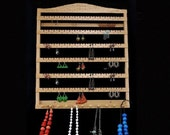 Custom large hanging earring holder with 6 earring slats and top area that can be customized