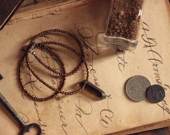 Mojo | Earth. Rustic Bohemian Hand Beaded Metallic Matte Bronze and Smoky Quartz Necklace.