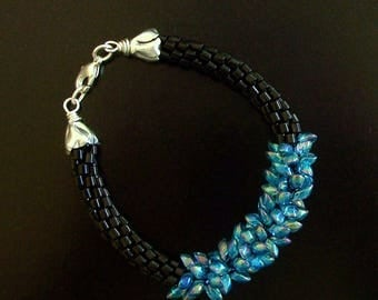 Black Beaded Kumihimo Woven Bracelet with a Focal of Iridescent Blue Magatama Beads by Carol Wilson of Je t'adorn