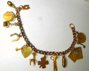 1960s  RETRO 12 Charm Bracelet, Mid Century Motifs of Bowling Pin, Diary, Bullet, Lie Detector, Shamrock, Horseshoe, Scissor, etc