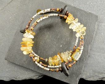 A ray of sunshine  an adjustable wrap bracelet made with super rounded genuine Maine sea stones and citrine beads