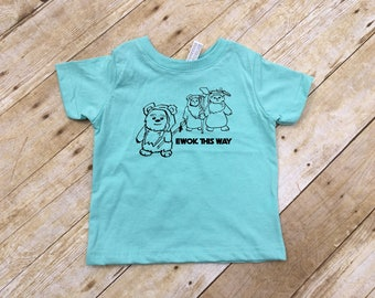 Ewok this way. Ewok this way shirt. Infant, toddler, youth sizes. Ewok shirt. Galaxy shirt. Space shirt. Vacation shirt. Fandom shirt.