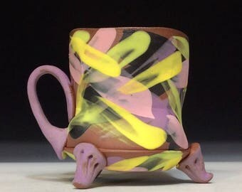 Matte multi color mug with lilac feet and handle