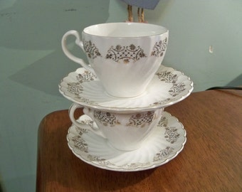 snowhite regency Johnson bros made in England 2 sets of cups and saucers