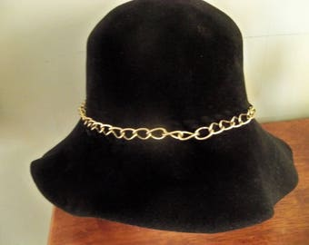 very soft floppy black hat with chain