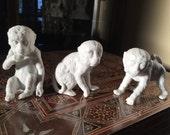 Three bisque monkeys