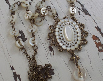 Vintage Carved Mother of Pearl Oval and Buttons  assemblage necklace by ceeceedesigns on etsy