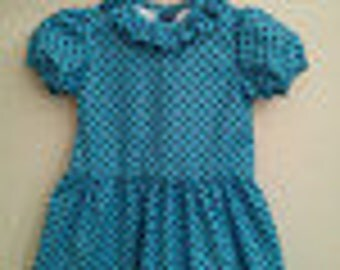 blue polka dots kids dress inspired by the Sally Brown dress
