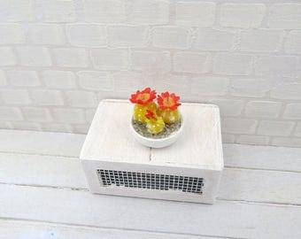 Three cacti with red flowers in bowl in 1:12 scale