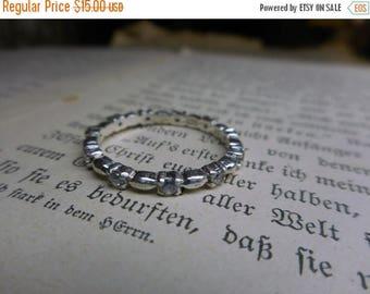 Vintage CZ & Sterling Silver simulated diamond Infinity style skip dot band prong set wedding band ring. Size 8