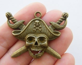 2 Pirate skull pendants bronze tone BC113