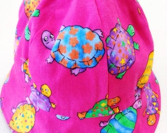 Girl's handmade hat 100% cotton bright pink turtles lined size 50cm fit 2-3 years free Aus post.