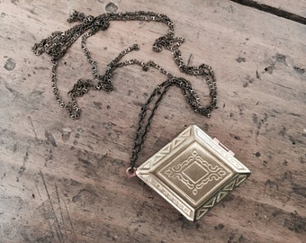 An authentic aged vintage diamond shaped locket necklace, brass soldered chain, put your secret message inside
