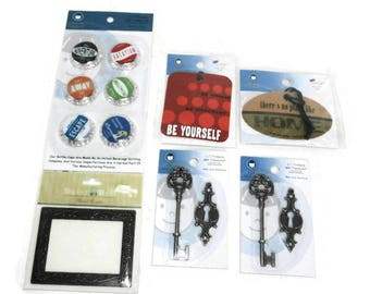 6 Craft Embellishment Assortment  New Packages Li'l Davis Designs & Daisy Hill Bottle Caps Key and Keyhole  Chip Art Tags Metal Accent Frame