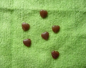 Bead, Czech pressed glass, marbled opaque to translucent brown / red / yellow, 10mm puffed heart. Package of 12