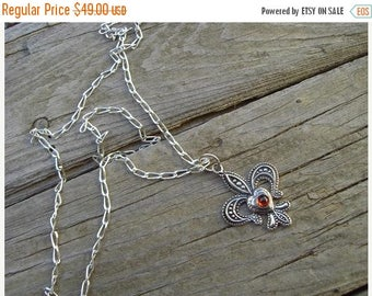 ON SALE Fleur de lis necklace in sterling silver with a garnet