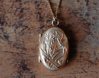 Antique Victorian oval photo locket with Lily of the Valley and tiny bird