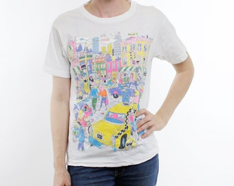 Vintage 80's t-shirt, bustling cartoon cityscape, busy metro area, neon bright colors, puffy accents, lightweight cotton - Small