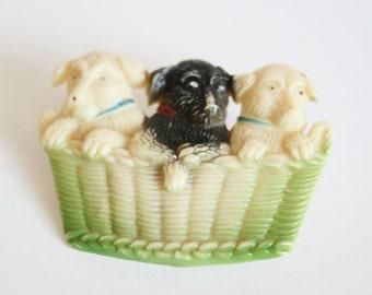 Vintage plastic dog brooch. 3 puppies in a basket brooch