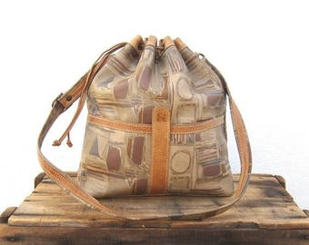 15% Off Out of Town Sale SALE Vintage Large Graphic Distressed Tan Leather Drawstring Bucket Bag