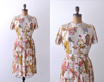 1960's music print dress. vintage. 60's cream & pink dress. gold. pleated skirt. m.