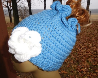 Crocheted Messy Bun/ Ponytail Beanie in Blue with Detachable  Flower in White