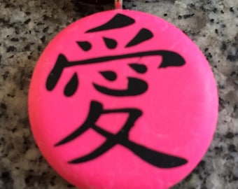 LOVE Japanese kanji symbol hand carved on a polymer clay neon pink pearl color background. Pendant comes with a FREE necklace.