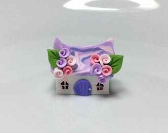 Miniature fairy cottage in pink and lilac handmade from polymer clay