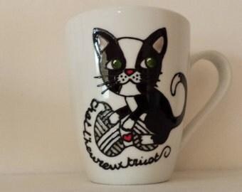 handpainted Knitting kitty on white mug