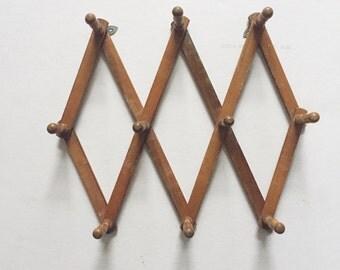 vintage accordion wood peg wall hanging rack // hat display storage // organizer