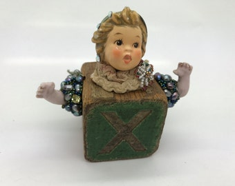 X Block Kid by Betsy Youngquist