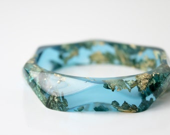 ocean blue wavy eco resin bangle with gold flakes