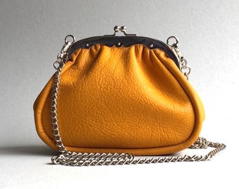 Frame clutch, kiss lock purse in golden yellow full grain Italian cow leather.