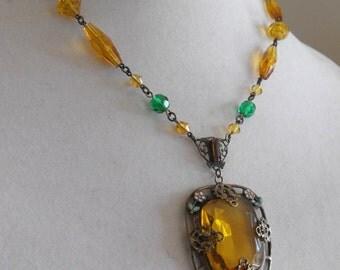 ART DECO topaz glass enamel pendant.  Art Nouveau amber glass lavalier