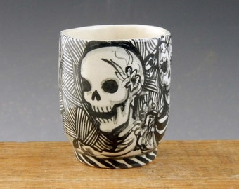 "Day of the dead porcelain shot glass demitasse cup in black and white with skulls and "" Live it up"""