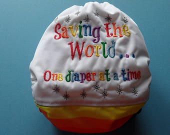 """SassyCloth one size pocket diaper with """"Saving the world one diaper at a time"""" embroidery on PUL. Ready to ship."""