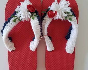 Ladies Red White and Blue Flip Flops with White Crocheted Strap and Pom Poms and Red Rose
