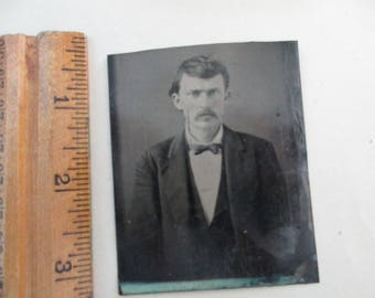 antique tintype - man with mustache, bow tie